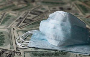 Medical face masks on hundred dollar bills