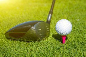 Driver, golf ball, pink tee